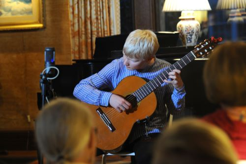 Student Plays Guitar - Portland Conservatory of Music